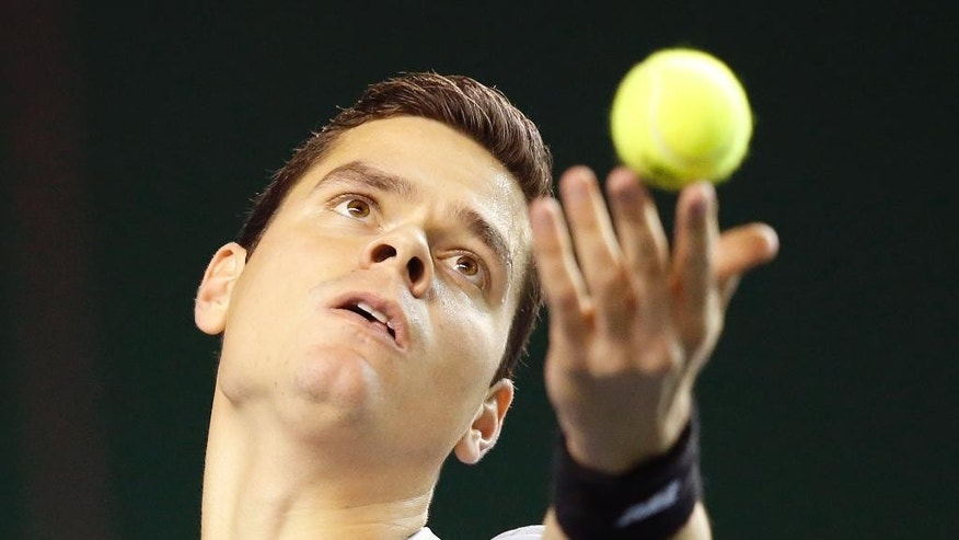 Milos Raonic of Canada, serves the ball to Jack Sock of the United States during their first round match at the ATP World Tour Masters tennis tournament at Bercy stadium in Paris, France, Wednesday, Oct. 29, 2014. (AP Photo/Michel Euler)
