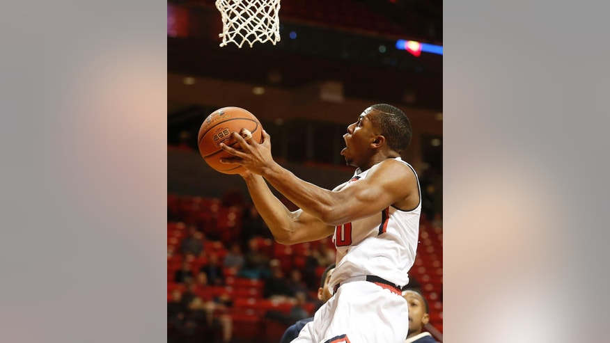 FILE - In this Dec. 30, 2013, file photo,Texas Tech's Toddrick Gotcher scores against Mount St. Mary's during an NCAA college basketballl game in Lubbock, Texas. This season, Texas Tech is aiming to win those games that are close at the end. The Red Raiders lost nine conference games by single digits. (AP Photo/Lubbock Avalanche-Journal/Stephen Spillman, File)  ALL LOCAL TV OUT