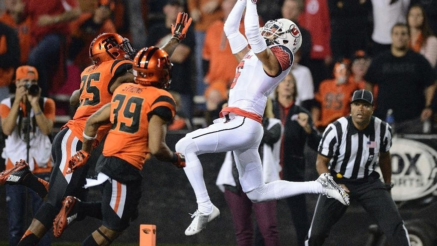 FILE - In this Oct. 16, 2014, file photo, Utah wide receiver Dres Anderson (6) catches a pass in the end zone during the first quarter against Oregon State in an NCAA college football game in Corvallis, Ore. The pass was ruled incomplete after Anderson had the ball knocked out of his hands. Dres Anderson will miss the rest of the season with a knee injury.The Utes announced the injury to their top receiver Wednesday, Oct. 29, 2014. (AP Photo/Troy Wayryne, File)