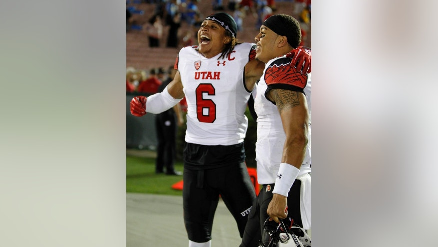 FILE - In this Oct. 4, 2014, file photo, Utah wide receiver Dres Anderson (6) celebrates with quarterback Kendal Thompson, right, after defeating UCLA in an NCAA college football game in Pasadena, Calif. Dres Anderson will miss the rest of the season with a knee injury.The Utes announced the injury to their top receiver Wednesday, Oct. 29, 2014. (AP Photo/Alex Gallardo, File)