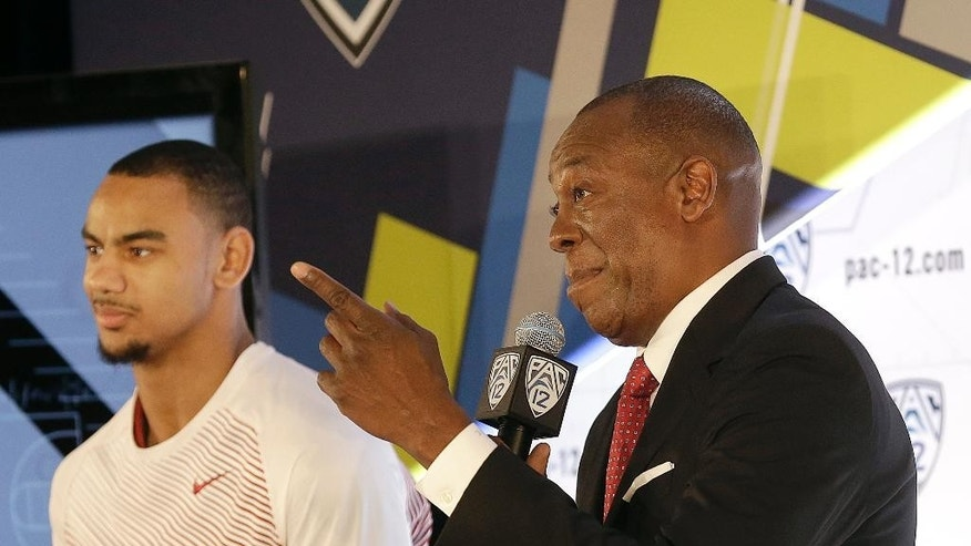 FILE - In this photo taken Oct. 23, 2014, Washington State head coach Ernie Kent, right, speaks next to guard DaVonte Lacy during NCAA college basketball Pac-12 media day in San Francisco. Kent will try to revive a Washington State basketball program that had slumped in five years under Ken Bone, who was fired at the end of last season. (AP Photo/Jeff Chiu, file)