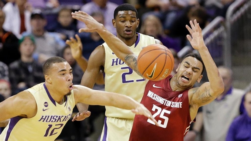 FILE - In this photo taken Feb. 28, 2014,  Washington's Andrew Andrews (12) knocks the ball away from Washington State's DaVonte Lacy (25) for a turnover during an NCAA college basketball game in Seattle. Both Andrews and Lacy are expected to play major roles on their teams in the upcoming season. (AP Photo/Elaine Thompson. file)