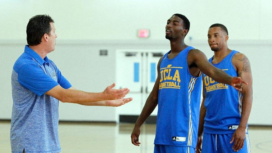 In this Oct. 14, 2014, photo, UCLA head coach Steve Alford, left, directs guard Isaac Hamilton, center, and guard Norman Powell during practice for the NCAA college basketball team's media day in Los Angeles. He's got one returning starter in senior Powell, who averaged 11.4 points and 2.8 rebounds. The rest of the Bruins are mostly unproven, which led to them being picked by the media to finish fourth in the Pac-12. (AP Photo/Alex Gallardo)