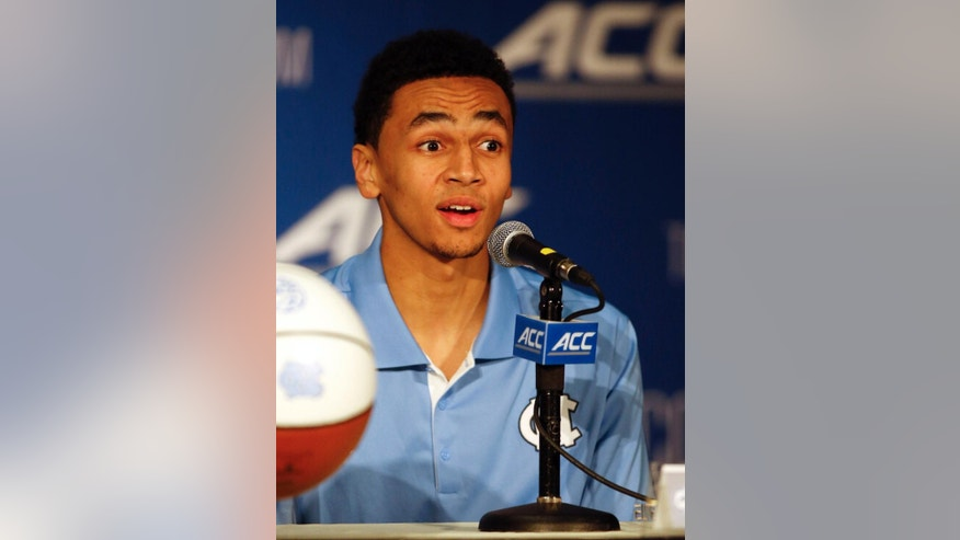 North Carolina's Marcus Paige answers a question at the Atlantic Coast Conference NCAA college basketball media day in Charlotte, N.C., Wednesday, Oct. 29, 2014. (AP Photo/Nell Redmond)