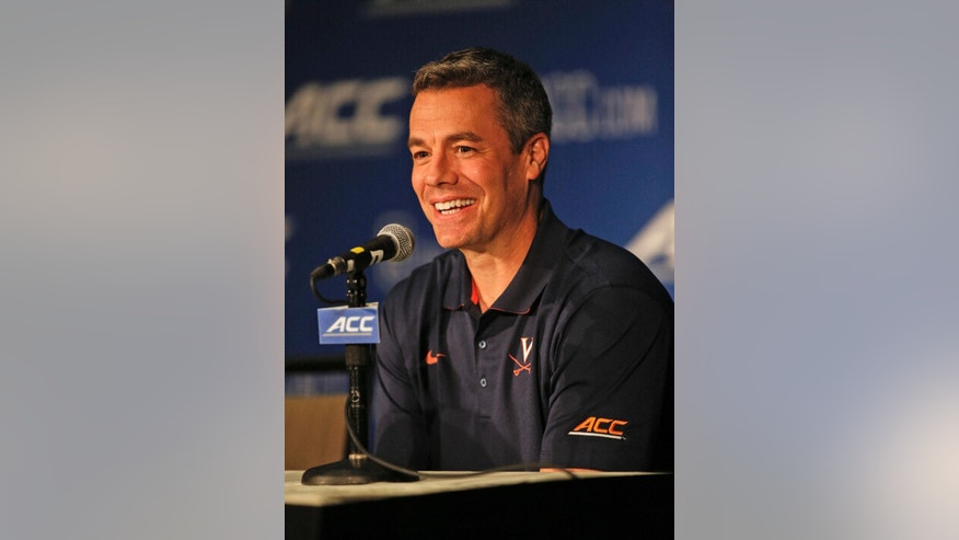 Virginia basketball coach Tony Bennett answers a question at the Atlantic Coast Conference NCAA college basketball media day in Charlotte, N.C., Wednesday, Oct. 29, 2014. (AP Photo/Nell Redmond)
