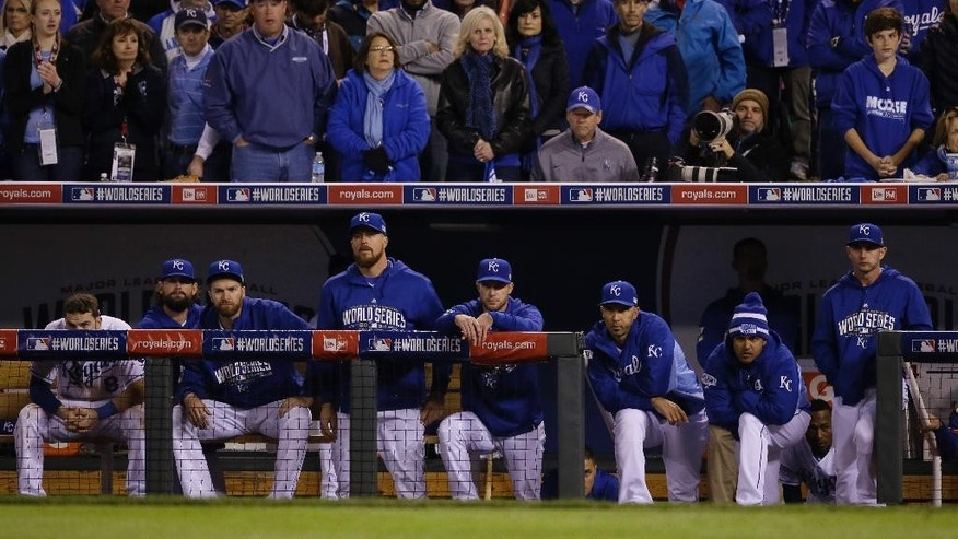 Kansas City Royals players watch from their dugout the seventh inning of Game 7 of baseball's World Series against the San Francisco Giants Wednesday, Oct. 29, 2014, in Kansas City, Mo. (AP Photo/Charlie Neibergall)