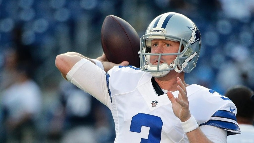 """FILE - In this Aug. 7, 2014, file photo, Dallas Cowboys quarterback Brandon Weeden throws during warmups for a preseason NFL football game against the San Diego Chargers in San Diego. Weeden had led scoring drives on the only two possessions Tony Romo missed against Washington when the Dallas starter tapped his backup on the shoulder and said, """"Hey man, hell of a job. I'm going back in.""""(AP Photo/Jae C. Hong, File)"""