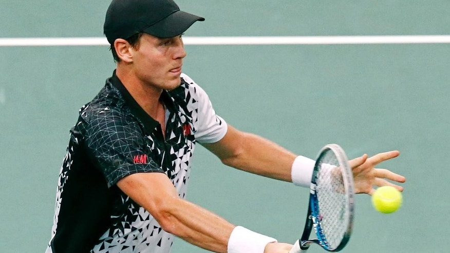 Tomas Berdych of the Czech Republic, returns the ball to Feliciano Lopez of Spain during their third round match at the ATP World Tour Masters tennis tournament at Bercy stadium in Paris, France, Thursday, Oct. 30, 2014. (AP Photo/Michel Euler)