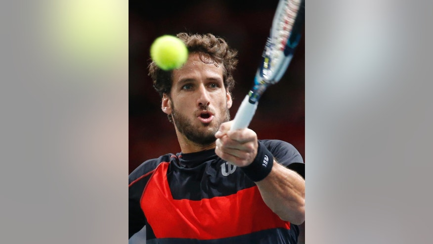 Feliciano Lopez of Spain, returns the ball to Tomas Berdych of the Czech Republic during their third round match at the ATP World Tour Masters tennis tournament at Bercy stadium in Paris, France, Thursday, Oct. 30, 2014. (AP Photo/Michel Euler)