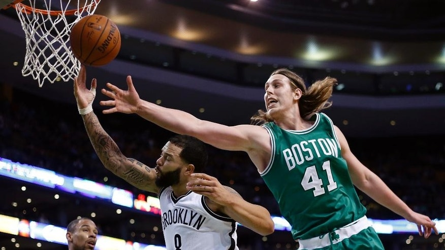 Boston Celtics center Kelly Olynyk (41) reaches to defend against a drive by Brooklyn Nets guard Deron Williams (8) in the second half of an NBA basketball game in Boston, Wednesday, Oct. 29, 2014. The Celtics won 121-105. (AP Photo/Elise Amendola)