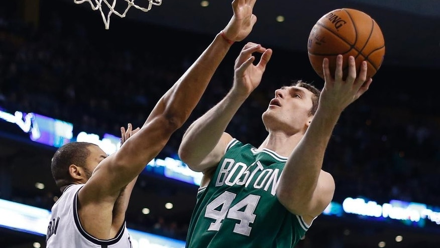 Boston Celtics center Tyler Zeller (44) goes up for a shot against Brooklyn Nets center Jerome Jordan (9) in the first quarter of an NBA basketball game in Boston, Wednesday, Oct. 29, 2014. (AP Photo/Elise Amendola)