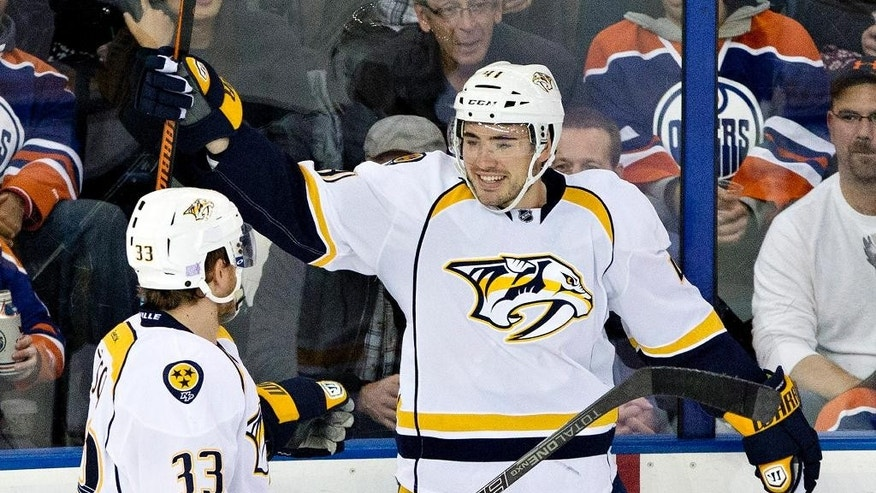 Nashville Predators' Colin Wilson (33) and Taylor Beck (41) celebrate a goal against the Edmonton Oilers during the second period of an NHL hockey game, Wednesday, Oct. 29, 2014 in Edmonton, Alberta. (AP Photo/The Canadian Press, Jason Franson)