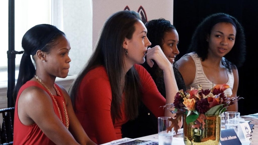 UConn women's basketball players Moriah Jefferson, Breanna Stewart, Kaleena Mosqueda-Lewis, and Kiah Stokes, left to right, listen to coaches' remarks during the American Athletic Conference women's NCAA college basketball media day, in New York,  Thursday, Oct. 30, 2014. (AP Photo/Richard Drew)