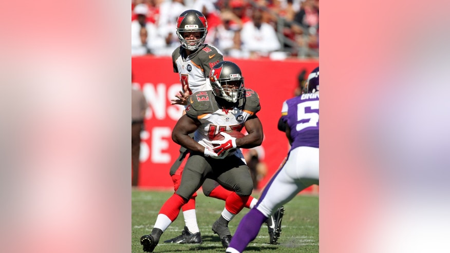 Tampa Bay Buccaneers running back Bobby Rainey (43) takes the handoff from quarterback Mike Glennon (8) during the second half of an NFL football game against the Minnesota Vikings, Sunday, Oct. 26, 2014, in Tampa, Fla. The Vikings won 19-13. (AP Photo/Reinhold Matay)