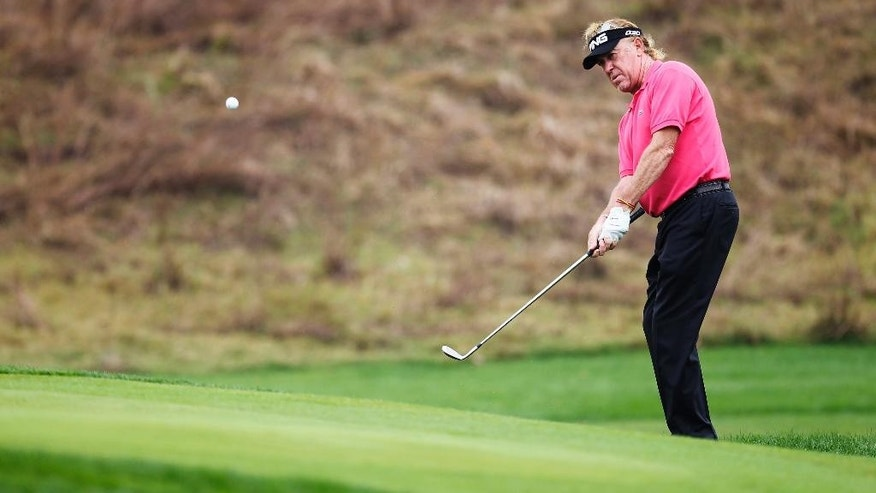 Miguel Angel Jimenez of Spain hits on the 14th hole during the first round of the BMW Masters golf tournament at the Lake Malaren Golf Club  in Shanghai, China Thursday Oct. 30, 2014. (AP Photo)