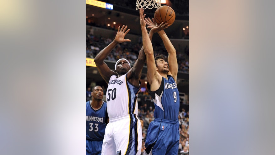 Memphis Grizzlies forward Zach Randolph (50) shoots against Minnesota Timberwolves guard Ricky Rubio (9) in the first half of an NBA basketball game Wednesday, Oct. 29, 2014, in Memphis, Tenn. (AP Photo/Brandon Dill)