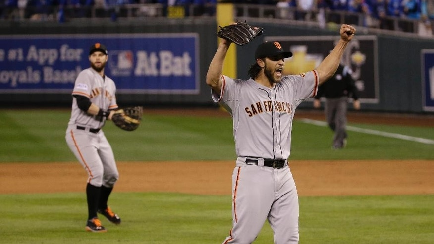 San Francisco Giants pitcher Madison Bumgarner celebrates after winning 3-2 to win the series over Kansas City Royals after Game 7 of baseball's World Series Wednesday, Oct. 29, 2014, in Kansas City, Mo. (AP Photo/Matt Slocum)