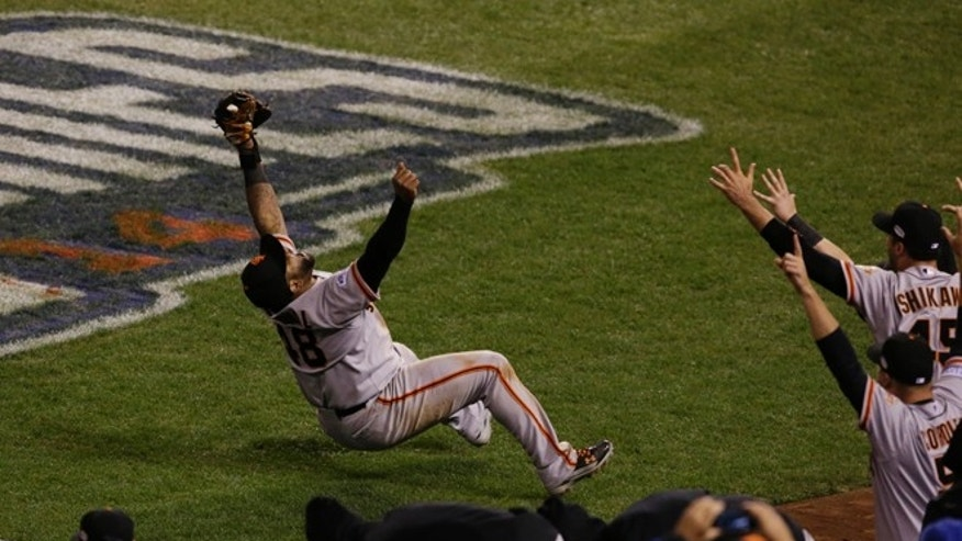San Francisco Giants Pablo Sandoval catches the last out a pop fly by Kansas City Royals Salvador Perez during the ninth inning of Game 7 of baseball's World Series Wednesday, Oct. 29, 2014, in Kansas City, Mo. The Giants won 3-2 to win the series. (AP Photo/Orlin Wagner)