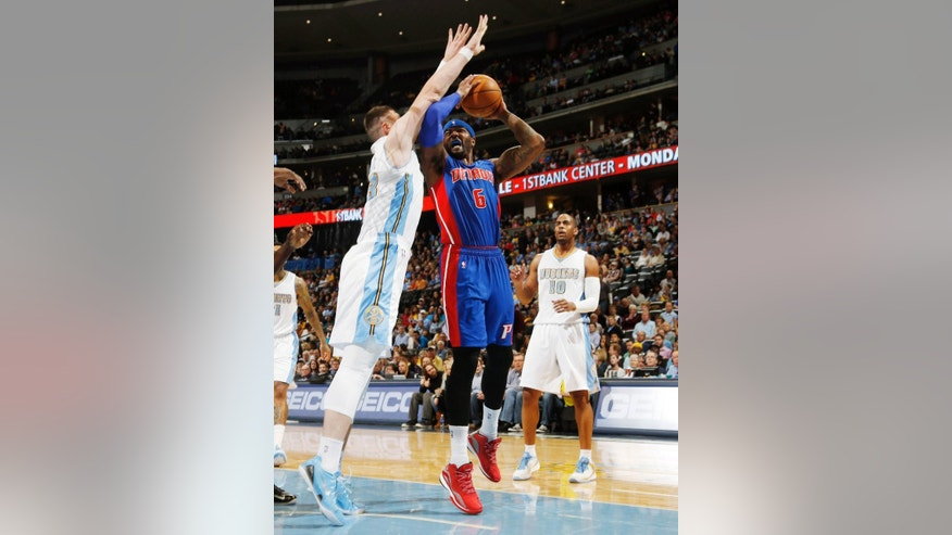Detroit Pistons forward Josh Smith, center, drives lane for shot as Denver Nuggets center Jusuf Nurkic, left, of Bosnia Herzegovina, and guard Arron Afflalo cover in the first quarter of an NBA basketball game in Denver on Wednesday, Oct. 29, 2014. (AP Photo/David Zalubowski)