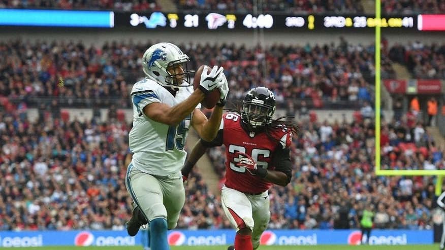 Detroit Lions wide receiver Golden Tate (15) catches the ball to score a touchdown during the NFL football game against Atlanta Falcons at Wembley Stadium, London, Sunday, Oct. 26, 2014.  (AP Photo/Tim Ireland)