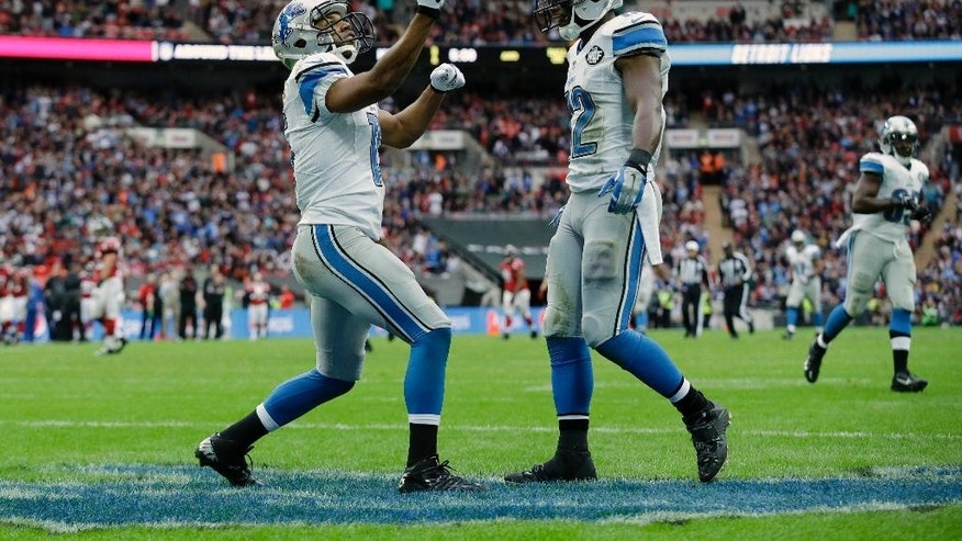 Detroit Lions wide receiver Golden Tate (15) celebrates a touchdown with wide receiver Jeremy Ross (12)in the second half of the NFL football game at Wembley Stadium, London, Sunday, Oct. 26, 2014.  (AP Photo/Matt Dunham)