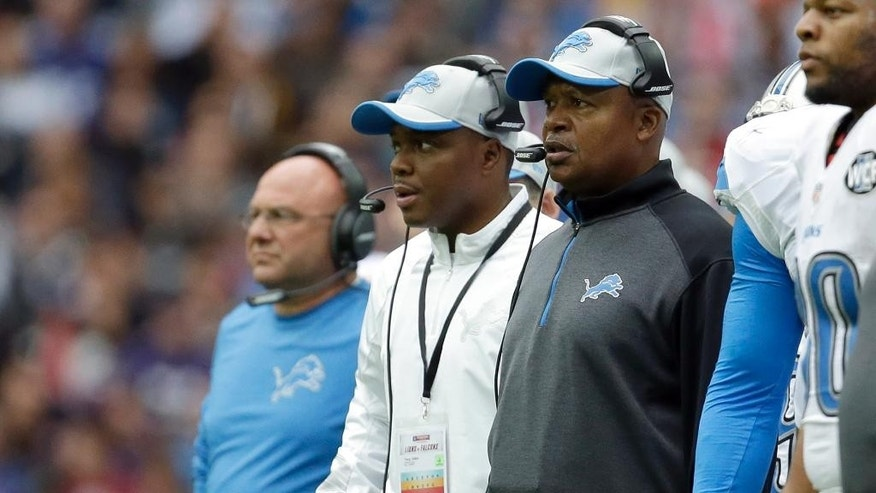 Detroit Lions head coach Jim Caldwell, right, watches in the first half of the NFL football game against the Atlanta Falcons at Wembley Stadium, London, Sunday, Oct. 26, 2014.  (AP Photo/Matt Dunham)