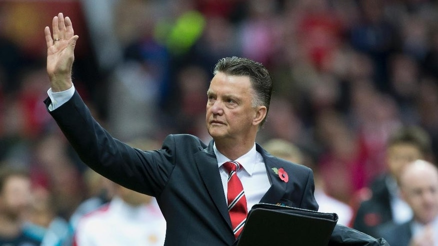 Manchester United's manager Louis van Gaal waves as he walks down the touchline before his team's English Premier League soccer match against Chelsea at Old Trafford Stadium, Manchester, England, Sunday Oct. 26, 2014. (AP Photo/Jon Super)