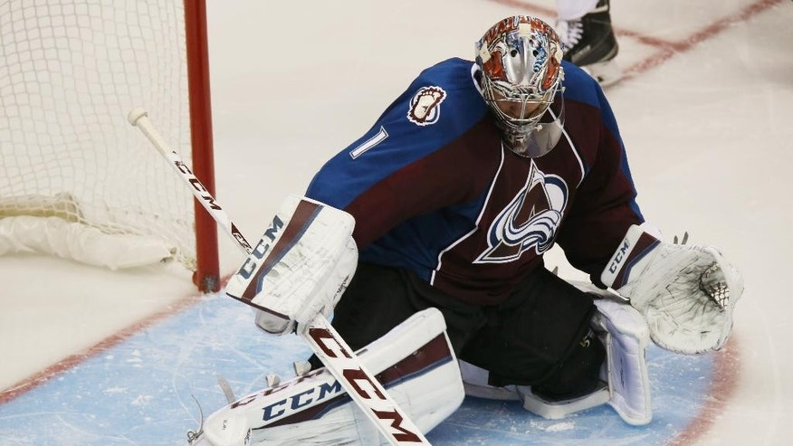 Colorado Avalanche goalie Semyon Varlamov, of Russia, makes pad save off a shot against the New York Islanders in the second period of an NHL hockey game in Denver on Thursday, Oct. 30, 2014. (AP Photo/David Zalubowski)