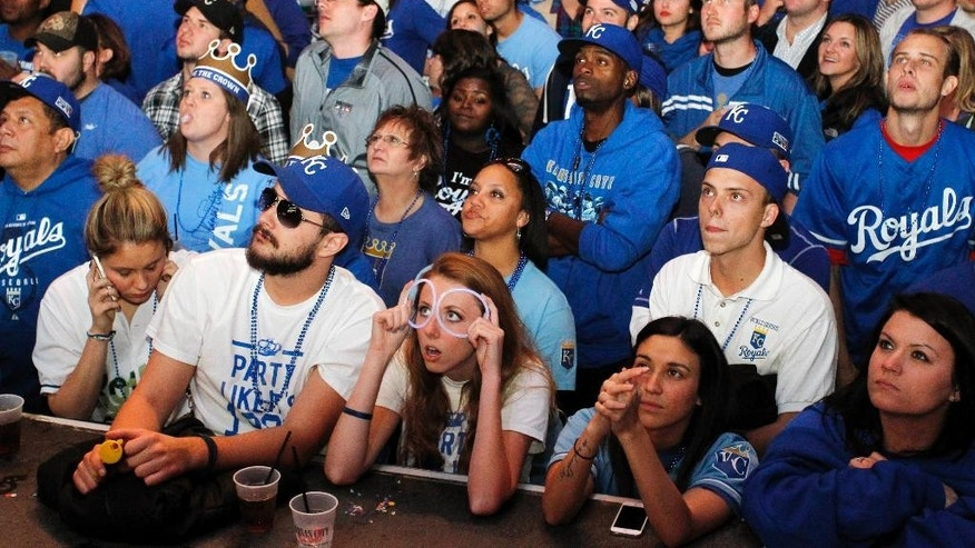 Kansas City Royals fans react as they watch Game 7 of the World Series in the Power and Light entertainment district in Kansas City, Mo., Wednesday, Oct. 29, 2014.  (AP Photo/Colin E. Braley)