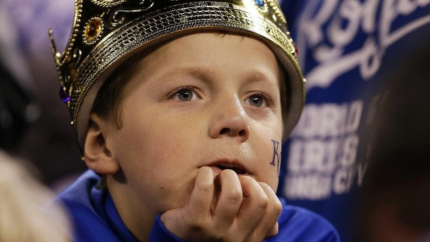 A Kansas City Royals fan watches during the ninth inning of Game 7 of baseball's World Series against the San Francisco Giants, Wednesday, Oct. 29, 2014, in Kansas City, Mo. (AP Photo/David J. Phillip)