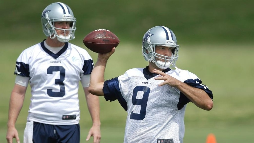 "FILE - In this June 18, 2014, file photo, Dallas Cowboys quarterback Tony Romo (9) passes as back-up quarterback Brandon Weeden (3) looks on during an NFL football minicamp in Irving, Texas. Weeden had led scoring drives on the only two possessions Romo missed against Washington when the Dallas starter tapped his backup on the shoulder and said, ""Hey man, hell of a job. I'm going back in.""(AP Photo/LM Otero, File)"