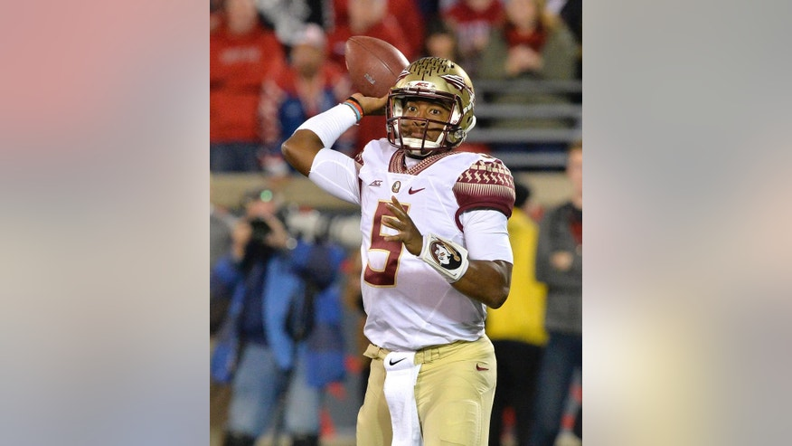 Florida State quarterback Jameis Winston attempts a pass during the second half of an NCAA college football game against Louisville in Louisville, Ky., Thursday, Oct. 30, 2014. Florida State won 42-31. (AP Photo/Timothy D. Easley)