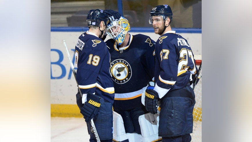 St. Louis Blues' goalie Jake Allen (34) is congratulated by Jay Bouwmeester (19) and Alex Peirtangelo (27) after their 2-0 victory over the  Anaheim Ducks in an NHL hockey game, Thursday, Oct. 30, 2014, in St. Louis. (AP Photo/Bill Boyce)