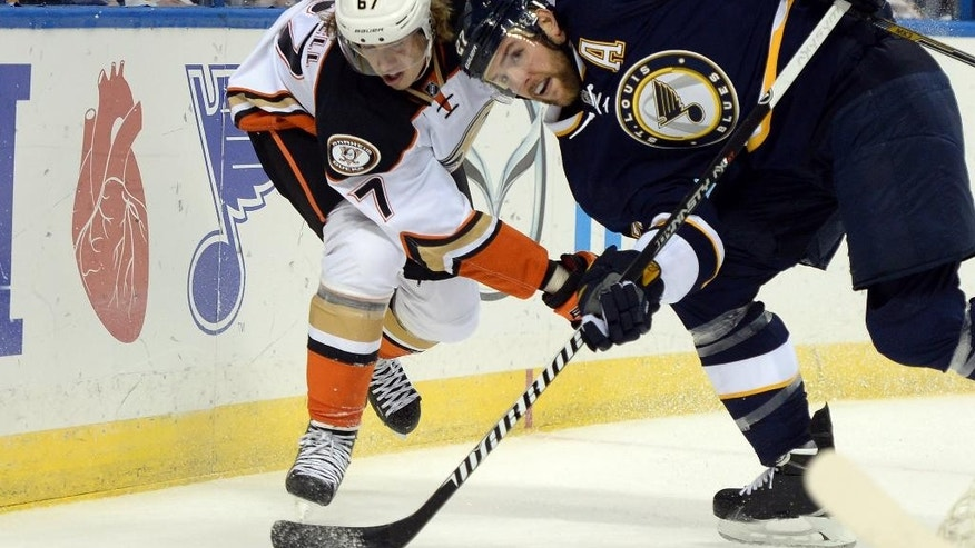 St. Louis Blues' Alex Pietrangelo (27) and Anaheim Ducks' Rickard Rakell (67), of Sweden, battle for the puck during the first period of an NHL hockey game, Thursday, Oct. 30, 2014, in St. Louis. (AP Photo/Bill Boyce)