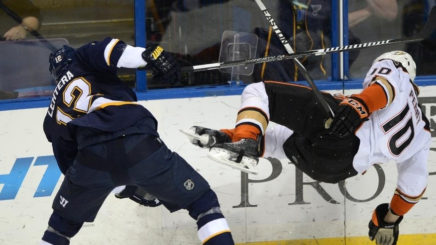 St. Louis Blues' Jori Lehtera (12), of Finland, is called for tripping Anaheim Ducks' Corey Perry (10) during the second period of an NHL hockey game, Thursday, Oct. 30, 2014, in St. Louis. (AP Photo/Bill Boyce)