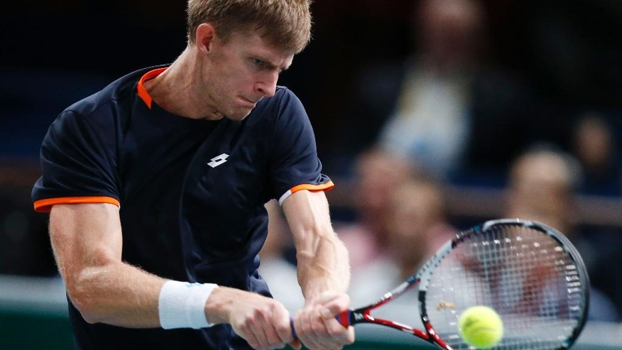 Kevin Anderson of South Africa returns the ball to Tomas Berdych of the Czech Republic during their quarterfinal match at the ATP World Tour Masters tennis tournament at Bercy stadium in Paris, France, Friday, Oct. 31, 2014. (AP Photo/Michel Euler)
