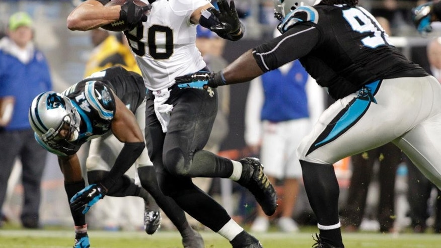 New Orleans Saints' Jimmy Graham (80) runs past Carolina Panthers' Colin Cole (91) in the second half of an NFL football game in Charlotte, N.C., Thursday, Oct. 30, 2014. (AP Photo/Bob Leverone)