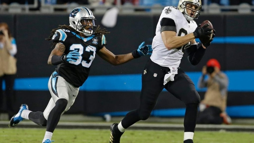 New Orleans Saints' Jimmy Graham, right, catches a pass as Carolina Panthers' Tre Boston, left, defends in the second half of an NFL football game in Charlotte, N.C., Thursday, Oct. 30, 2014. (AP Photo/Bob Leverone)