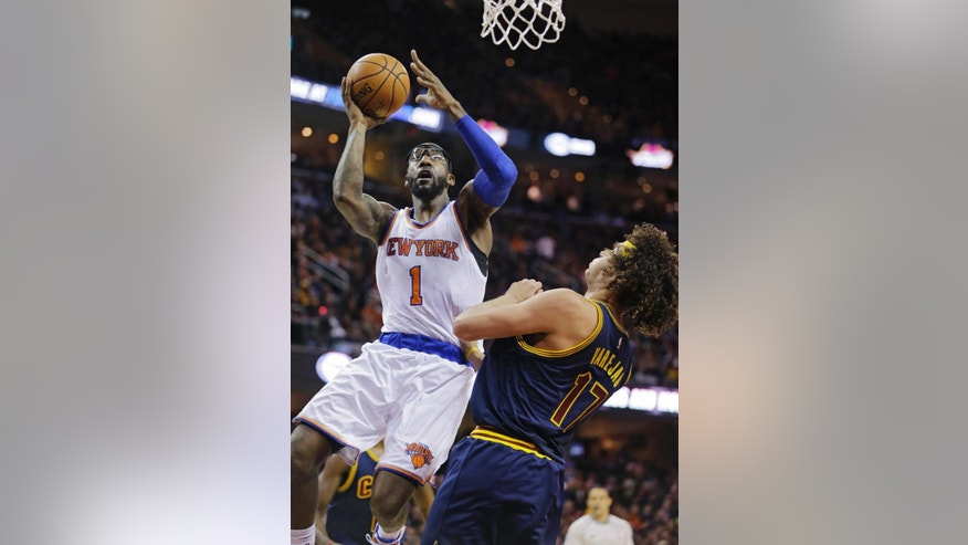 New York Knicks' Amar'e Stoudemire (1) shoots over Cleveland Cavaliers' Anderson Varejao (17), from Brazil, in the second quarter of an NBA basketball game Thursday, Oct. 30, 2014, in Cleveland. (AP Photo/Tony Dejak)