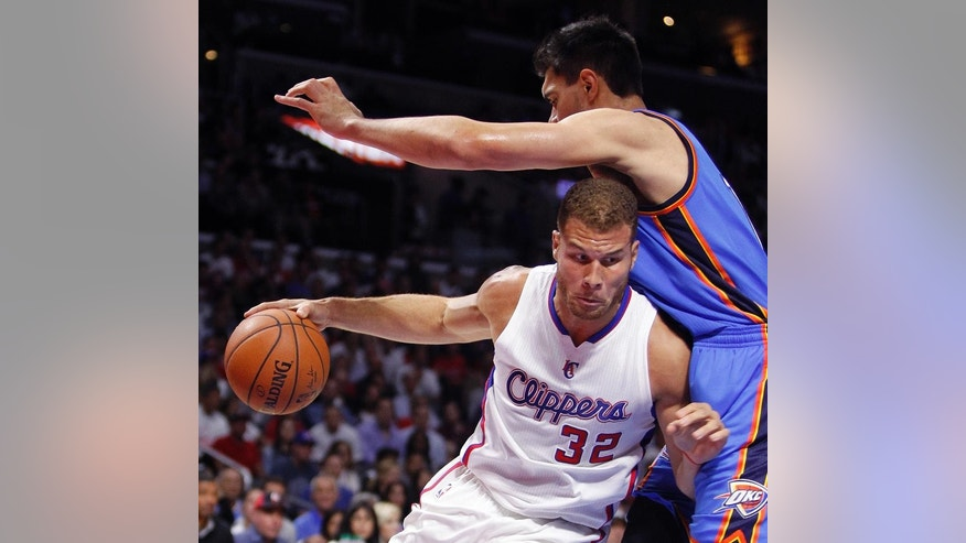 Los Angeles Clippers forward Blake Griffin (32) drives against Oklahoma City Thunder center Steven Adams (12), of New Zealand,  during the first half of an NBA basketball game in Los Angeles, Thursday, Oct. 30, 2014. (AP Photo/Alex Gallardo)