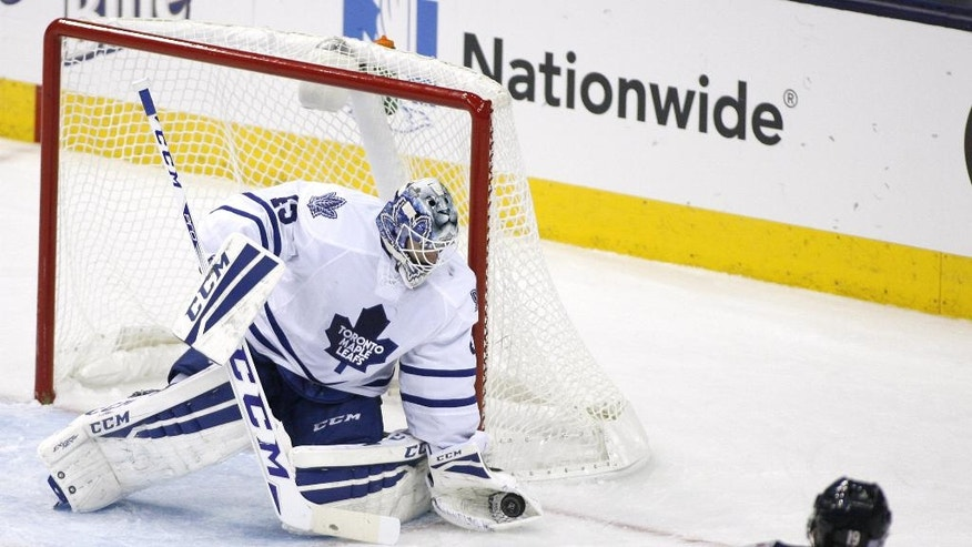 Toronto Maple Leafs goalie Jonathan Bernier (45) stops a shot by Columbus Blue Jackeys' Ryan Johansen (19) in the third period of an NHL hockey game, Friday, Oct. 31, 2014, in Columbus, Ohio. Toronto won 4-1. (AP Photo/Mike Munden)