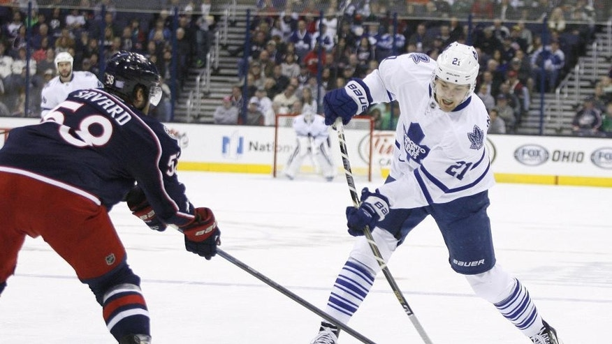 Columbus Blue Jackets' David Savard (58) tries to block the shot of Toronto Maple Leafs' James van Riemsdyk (21) in the first period of an NHL hockey game, Friday, Oct. 31, 2014, in Columbus, Ohio. (AP Photo/Mike Munden)