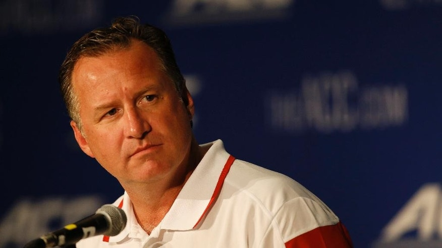 North Carolina State coach Mark Gottfried answers a question at the Atlantic Coast Conference NCAA college basketball media day in Charlotte, N.C., Wednesday, Oct. 29, 2014. (AP Photo/Nell Redmond)