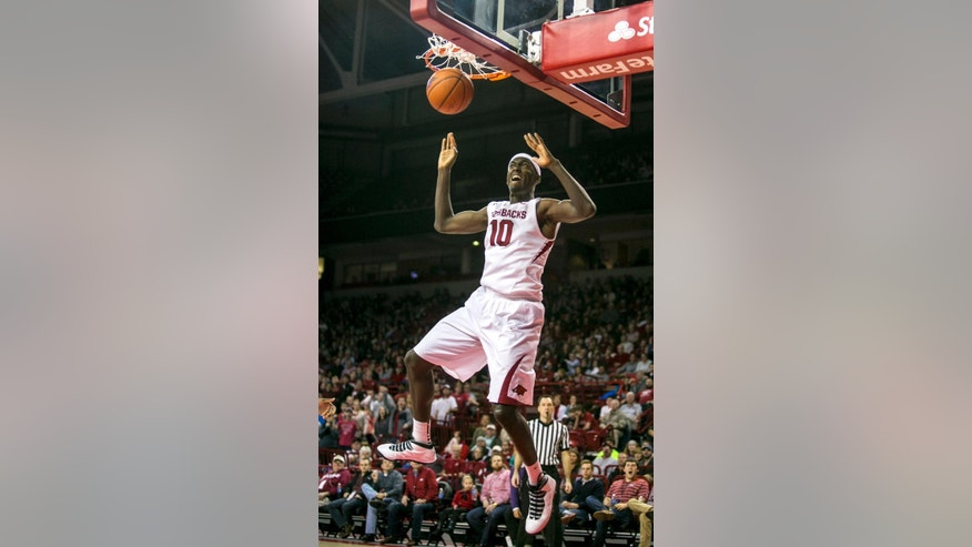 FILE - In this Feb. 5, 2014, file photo, Arkansas forward Bobby Portis (10) dunks during the first half of an NCAA college basketball game against Alabama .(AP Photo/Gareth Patterson, File)