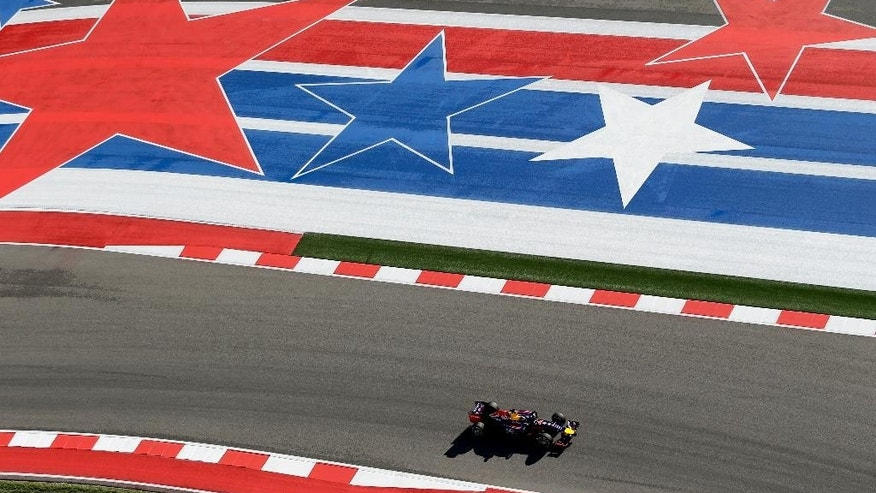 Red Bull driver Sebastian Vettel, of Germany, drives through the course during the first practice session for the Formula One U.S. Grand Prix auto race at the Circuit of the Americas, Friday, Oct. 31, 2014, in Austin, Texas. (AP Photo/Eric Gay)