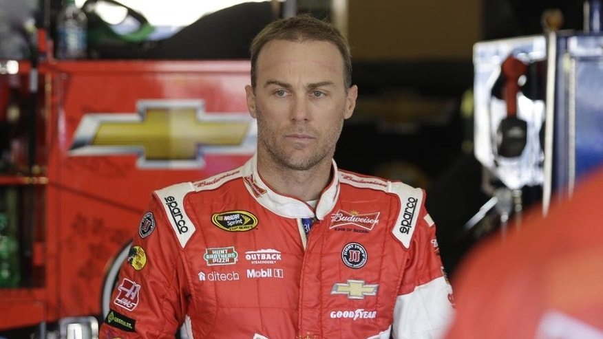 Sprint Cup Series driver Kevin Harvick stands in his garage during practice at Texas Motor Speedway in Fort Worth, Texas,  Friday, Oct. 31, 2014. Matt Kenseth says he feels terrible about the wreck that left Harvick last among the eight drivers still eligible in NASCAR's Chase for the Sprint Cup championship. (AP Photo/LM Otero)