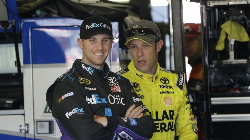 Sprint Cup Series drivers Denny Hamlin, left, and Matt Kenseth share a laugh while talking in the garage during practice at Texas Motor Speedway in Fort Worth, Texas,  Friday, Oct. 31, 2014. Drivers are preparing for the the Texas 500 auto race that runs Sunday. (AP Photo/LM Otero)