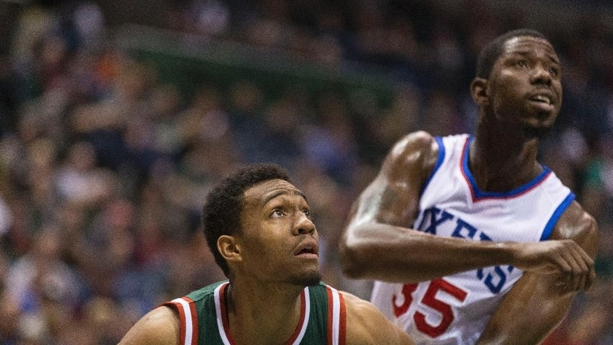 Milwaukee Bucks' Jabari Parker, left, blocks out Philadelphia 76ers Henry Sims during the first half of an NBA basketball game Friday, Oct. 31, 2014, in Milwaukee. (AP Photo/Tom Lynn)