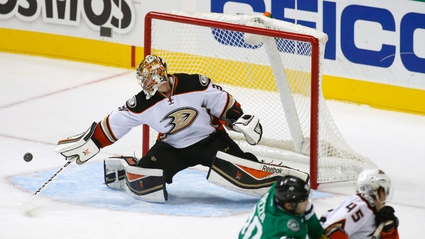 Anaheim Ducks goalie Frederik Andersen (31), of Denmark, makes a save as Dallas Stars center Jason Spezza (90) is kept away by Ducks defenseman Sami Vatanen (45) of FInland during the second period of an NHL hockey game Friday, Oct. 31, 2014, in Dallas. (AP Photo/Sharon Ellman)