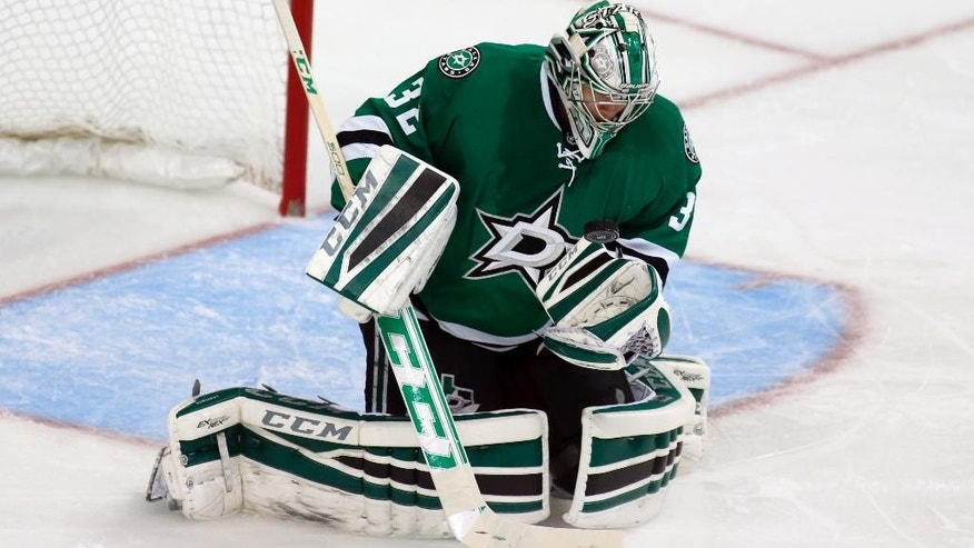 Dallas Stars goalie Kari Lehtonen (32), of FInland, makes a save during the second period of an NHL hockey game against the Anaheim Ducks Friday, Oct. 31, 2014, in Dallas. (AP Photo/Sharon Ellman)